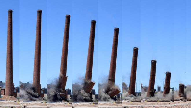 This series of photos shows the Hamilton Manufacturing Co.'s 233-foot smokestack crumble to the ground as it's toppled by explosions on May 31. Thousands of people flocked to see the demolition of the smokestack, which has towered over Two Rivers for more than 100 years.