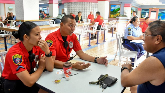 Officers Joneen Terlaje, left, and Eric Mondia take part in the Guam Police Department's outreach, Coffee with a Cop, at the Tamuning McDonald's restaurant on Jan. 25, 2017. Coffee with a Cop is a nationwide initiative to bring police officers and the community together to discuss issues and learn more about each other.