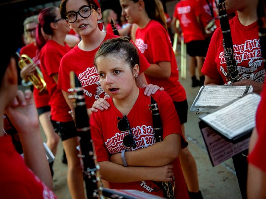 Freshman Autumn Michels, center, and senior Rachael Steffens, back, stand with other members of the clarinet section before the marching band's performance ahead of the homecoming football game on Friday, Sept. 22, 2017, at Laingsburg High School.