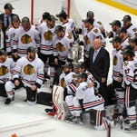 Members of the Chicago Blackhawks pose around the trophy after their win against the Anaheim Ducks in Game 7 of the Western Conference final of the NHL hockey Stanley Cup playoffs in Anaheim, Calif., Saturday, May 30, 2015. The Blackhawks won 5-3 to advance to Stanley Cup Finals.