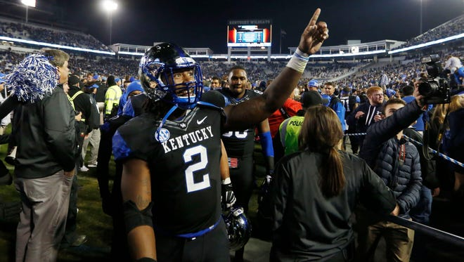 Oct 4, 2014; Lexington, KY, USA; Kentucky Wildcats defensive end Alvin Dupree (2) celebrates after defeating the South Carolina Gamecocks at Commonwealth Stadium. Kentucky defeated South Carolina 45-38. Mandatory Credit: Mark Zerof-USA TODAY Sports