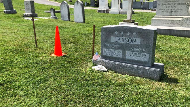 Sen. John McCain's burial plot is marked with two wooden stakes and an orange cone at the U.S. Naval Academy Cemetary in Annapolis, Md. He will be buried next to his old friend, and academy classmate, Chuck Larson.