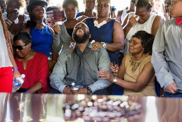 Michael Brown Sr. yells out