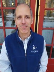 Stephen Schmidt, owner of Snapshot Science, poses for