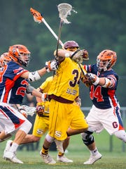 Salisbury University midfielder T.J. Logue (34) battles for possession on a face off against Gettysburg in the NCAA Division 3 Men's Lacrosse tournament on Sunday, May 22 at Sea Gull Stadium in Salisbury.