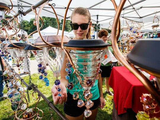 Megan Giesie of Wales shops at the JLE Designs booth during the Donna Lexa Memorial Art Fair in 2017. The 2020 event has been canceled due to concerns over the coronavirus.