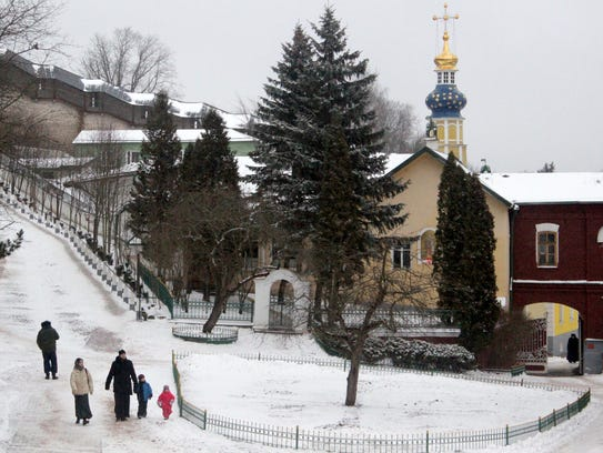 A family descends the steep Bloody Path to attend Orthodox