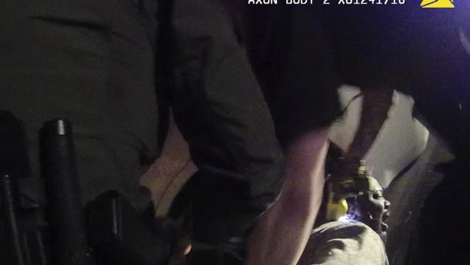 In this image made from a March 28, 2019, body-worn camera video provided by the Austin Police Department in Texas, Williamson County deputies hold down Javier Ambler as one of them uses a Taser on his back during his arrest in Austin, Texas.