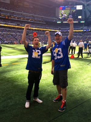 Jeremy Stevenson (left), with friend Jordie Cockburn on the field at a Colts game, has captivated fans and players with the insightful statistics he Tweets.