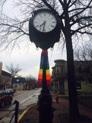 The borough's iconic clock gets a cozy scarf.