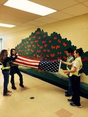 Four fifth-grade members of the Cedar Hill Safety Patrol ceremoniously folded the flag sent by U.S. Rep. Rodney P. Frelinghuysen to commemorate the 50th Anniversary of Cedar Hill Elementary School in Towaco.