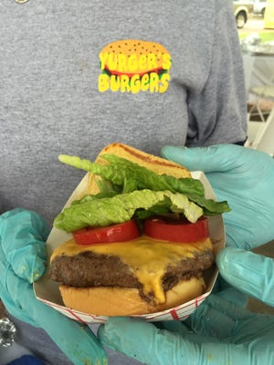The homestyle burger, loaded with fresh salad and created by Dr. Philip Gachassin's team, won the People's Choice award.