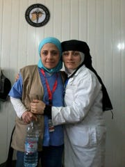 Dr. Hend Azhary (left) of Michigan State University's family medicine faculty is shown with Manal Auyjan, a Syrian nurse who has lived in the Zaatari refugee camp for two and half years.