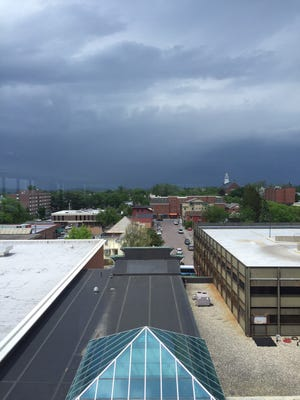 Storm clouds rise north of Burlington Wednesday afternoon, as seen from the Burlington Free Press newsroom on Bank Street.