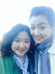 Shuo Pan, right, with her mother, Peiqing Li.
