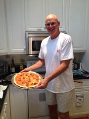 Tom Consol, of Long Valley, makes his homemade pizza with a closely-guarded secret sauce recipe.