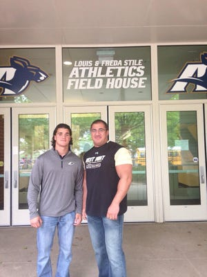 Visiting the University of Akron campus are Chuck Turfe and his dad, Norm Turfe.