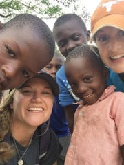 Fairfield girls' soccer junior varsity coach Jen Lee, bottom left, helped build a Young Life camp in Maissade, Haiti.