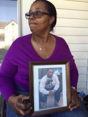 Lillian Webb holds a photo of her son, Myron Webb.