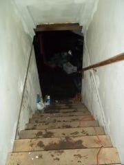 Water reached the top step of these stairs in Joan and Mark Hanson's North 10th Avenue basement. On the night of Sept. 4, water rushed through a broken window, almost filling their basement entirely. The Hansons' neighbor Brent Zocher is suing the city for damages from the same flood event.
