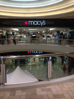 Customers enter a Macy's store in Tysons Corner Center in McLean, Va.