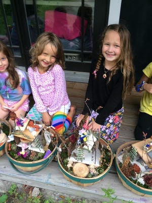 Happy campers pose with their Fairy Garden creations at Poker Hill Arts Fairy Camp.