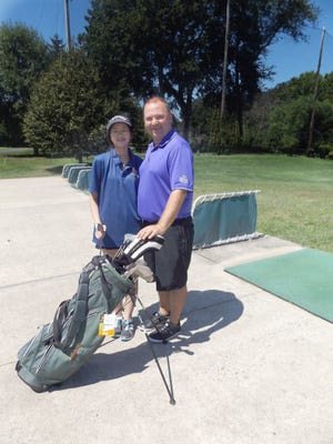 East Brunswick resident and First Tee student, Kaitlyn Lew, out on Tamarack's driving range with her instructor Mark McCabe.