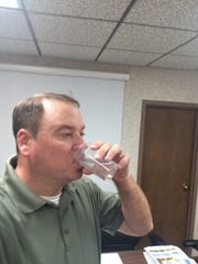 Darren Gore, director of the Murfreesboro Water and Sewer Department, drinks a glass of treated sewer water from the city's Sinking Creek wastewater-treatment plant.