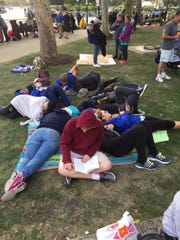 Students sit in Aviator Park waiting for the pope's afternoon Mass