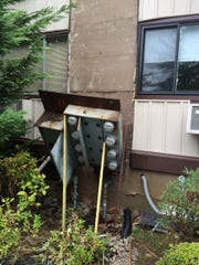Facade collapses at Mountainview Condominiums in Valley Cottage, scattering bricks and damaging gas line.