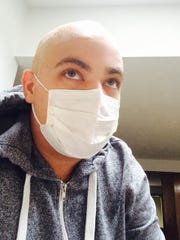 These days, Marcus Calverley's hair and beard are both shaved due to treatments on his cancer.
