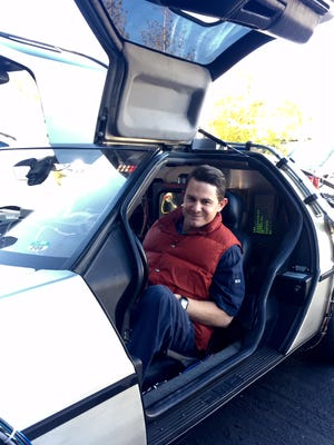 Jeff Gladding, 34, poses for a photo while sitting inside his DeLorean, made to look like an exact replica of the time machine in 'Back to the Future.'