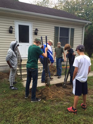 Students from Pocomoke High School help build a ramp for a Berlin resident.