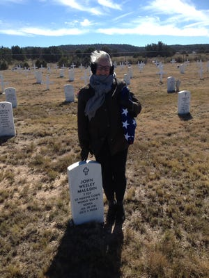 Pam Tomlin brought the flag from her father's funeral to the Ft. Stanton groundbreaking. Marine Staff Sgt John Mauldin fought and was wounded at both Guadalcanal and the Chosin Reservoir. He did in Ruidoso in 2004 and was buried at Ft. Stanton.