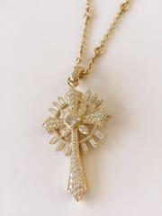 Stunning diamond cross surrounded in 14k gold, $46,000.