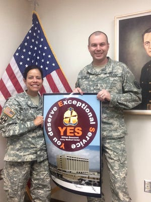 White Sands Missile Range U.S. Army McAfee Health Clinic Commander Lt. Col. Elba Villacorta, left, poses for a photo with McAfee Detachment Sergeant Staff Sgt. Anthony.