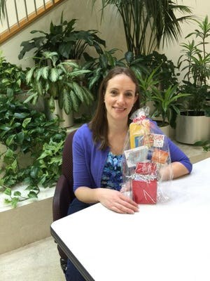 Lauren Kriegel, a social worker at the Rutgers Cancer Institute of New Jersey, is helping to brighten the holiday season for cancer patients by distributing gift cards .