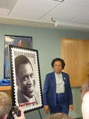 Evelyn Field speaks at the unveiling of a stamp honoring fellow Somerville High School graduate Paul Robeson.