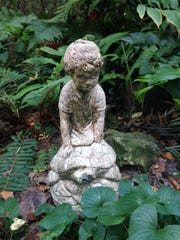 A statue can be a focal point for memory garden.