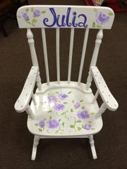 A personalized child's rocking chair from Write On Gifts in Denville.