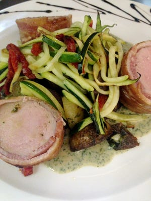 Pork tenderloin and Pesto sauce is one of the dishes at the new Voila Bistro.