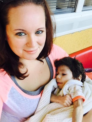 Priscilla Morse holds Ryan, who was adopted from a Bulgarian orphanage at age 7, weighing only 8 pounds.