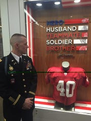 John Baer of Manchester Township is shown at the Pat Tillman memorial at NFL Headquarters after learning he is going to the Super Bowl.