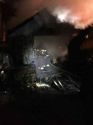 An image taken from the scene of a house fire in the 3100 block of Tharpe Street Monday night.