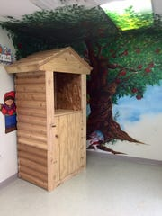 Matt Learned, another parent, contributed to Evan Peplin's theme by building a mini garden shed television stand and storage space for the students' educational movies.