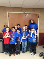 Fox Valley Christian Academy Chess Club members participated in a Wisconsin Scholastic Chess Federation tournament recently at FVCA. The team took home a first-place team trophy. Additionally, Christopher Burks, third grade, received a trophy for a first-place individual finish; and Owen Douglas, third grade, received a third-place individual trophy for the K-5 division.