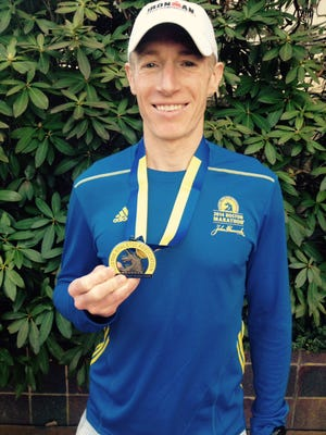 Richard Bounds, Delaware's fastest Boston Marathon runner, proudly displays his finishing medal.