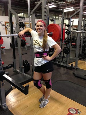 Groton High School senior Phyllis Rose recently broke the school's female squat record by 20 pounds.