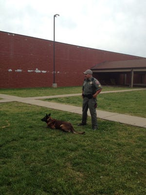 Rutherford County Deputy Sgt. Lee Young and his K-9 partner Ely put on a demonstration for the 50th class of the Sheriff's Citizens Academy.