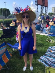 Laura Vande Boom wears a bouquet of white flowers, two American flag pinwheels and a handful of stars on her homemade hat.